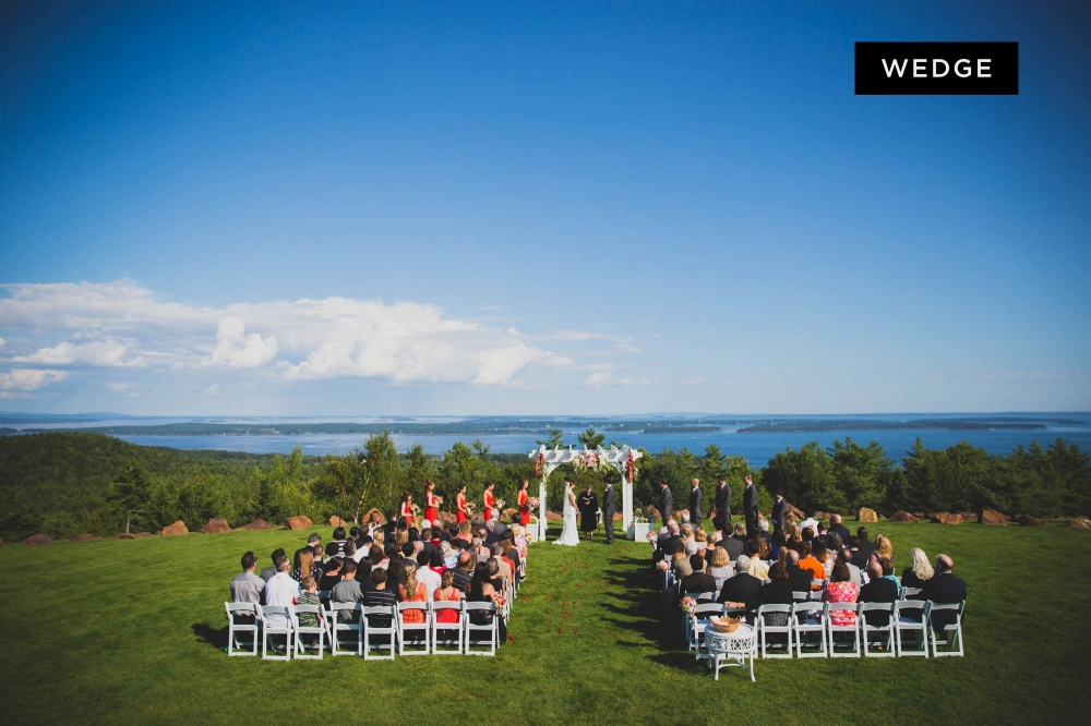A wedding ceremony & reception at Point Lookout Resort in Lincolnville, Maine. Photographs by The award winning photographers at Boathouse Studios.